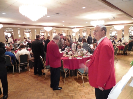 Banquet chairman Bob Lesiecki, right, checks things over as the ceremonies are about to begin