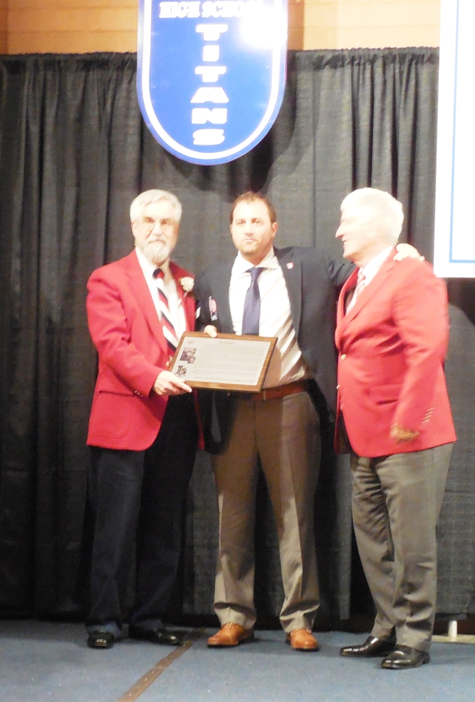 Enshrinee Christopher Dore, center, accepts his plaque from LSHOF President Tom Skoch, left and LSHOF Committee Member Neil Sommers