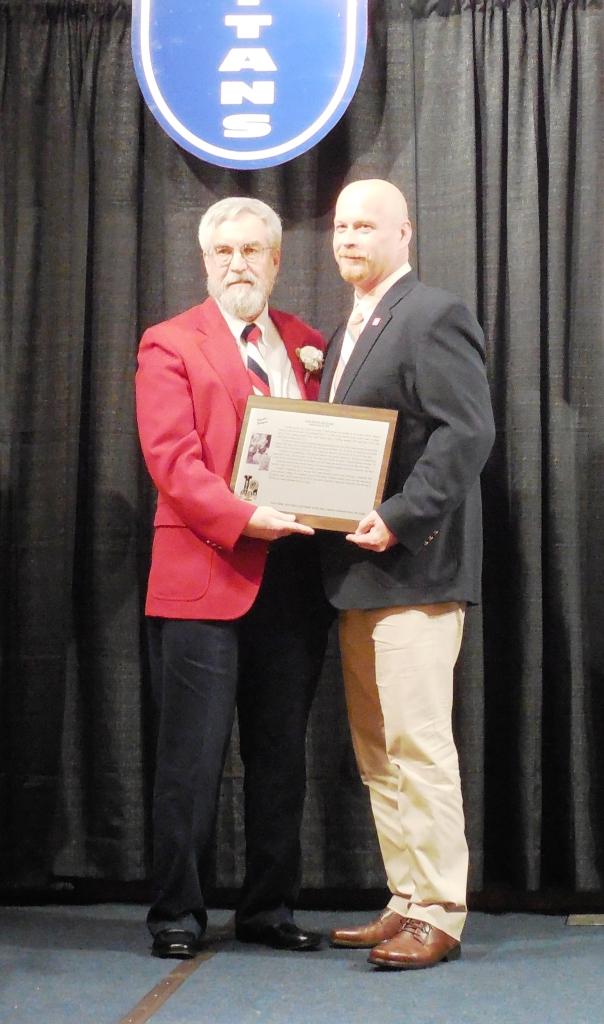 Enshrinee Jonathan Senters, right, accepts his plaque from Tom Skoch, LSHOF president 5.12.16