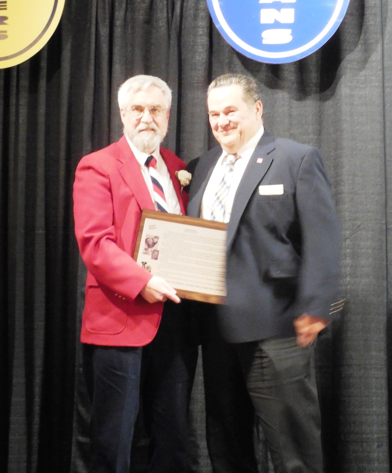 Enshrinee Tim Jenkins, right, accepts his plaque from Tom Skoch, LSHOF president