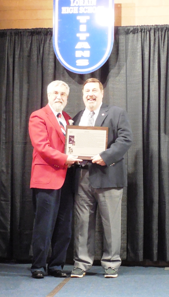Enshrinee Tom Bauer, right, accepts his plaque from LSHOF president Tom Skoch 5.12.16