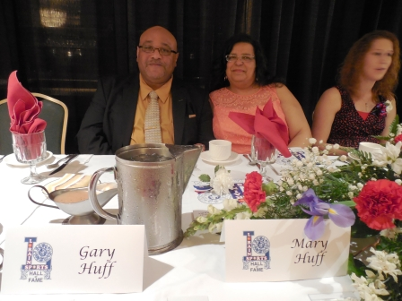From the left, inductee Gary Huff, his wife, Mary and inductee Holly Koepp.