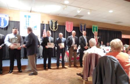 Members of the 1990 Lorain Catholic Baseball Team receive congratulations from LSHOF Committee Member Bob Tomaszewski