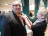 Barb McConihe of the LSHOF Committee pins a boutonniere on inductee Gary Huff