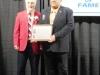 Enshrinee Gary Huff, right, accepts his plaque from Tom Skoch, LSHOF president 5.12.16