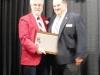 Enshrinee Tim Jenkins, right, accepts his plaque from Tom Skoch, LSHOF president
