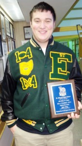 Tyler King is pictured with his plaque from the Sports Hall of Fame, which was presented to him at the LSHOF Museum in Lorain.