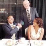 Emcee Ron Bakalar congratulates Eric Morrison