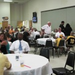 Guests socialize at the LSHOF Steak Fry Aug. 3.