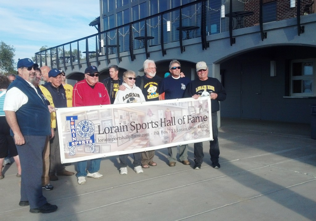 Members of the Lorain Sports Hall of Fame Committee, and friends, get ready to lead the Alumni Walk ceremony at the fourth Annual Lorain City Schools Homecoming Bonfire at Lakeview Beach on Sept. 25, 2014.