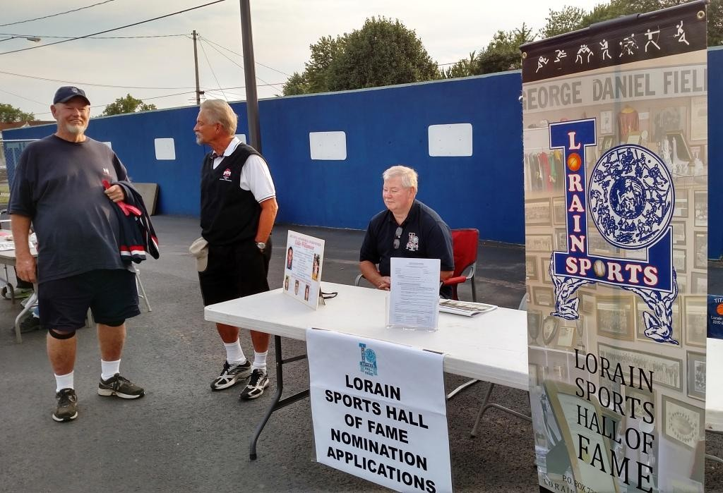 The Lorain Sports Hall of Fame attended the Lorain Titans first home game on Aug. 28, 2015, offering nomination forms for the public to suggest athletes who they think should be inducted in the hall of fame. Pictured are LSHOF Committee member Terry King, left, Vice President Bill Rufo and Past President Dave Simpson. (Photo by Tom Skoch, LSHOF president)