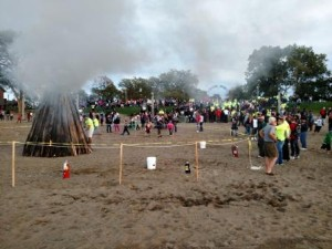 A large crowd gathered on the hillside overlooking Lakeview Beach as the 2015 Homecoming Bonfire was lit.