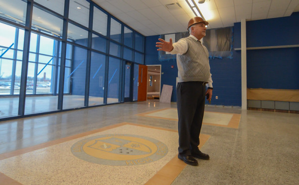 Jeff Hawks, executive director of operations of Lorain Schools, stands in the cafeteria portion of the new Lorain High School, Dec. 17, 2015. The glassed space behind Hawks will serve as home to the Lorain Sports Hall of Fame. (Photo by Eric Bonzar/The Morning Journal)