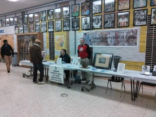 Tom Bauer and Bill Rufo at the Lorain Sports Hall of Fame display table, during the Lorain/Clearview basketball game on Jan. 16, 2016.