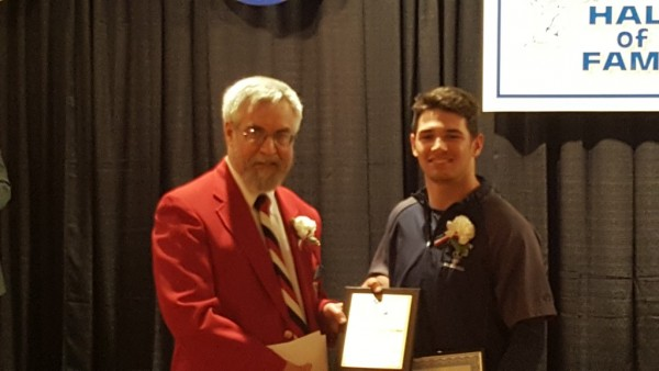 Brandon Bartlome receives the J. Ed Uland Award from Tom Skoch, <a href=