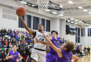 Lorain guard Jalil Little had a game-high 21 points in the Titans' 66-57 season-opening win over the Vermilion Sailors, Dec. 6, 2016. It was the first regular-season boys basketball game ever played in the gym at the new Lorain High School. (Morning Journal Photo by Eric Bonzar)